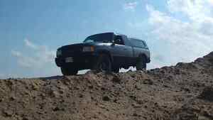 03 ford ranger 4x4 with cap. Good work truck