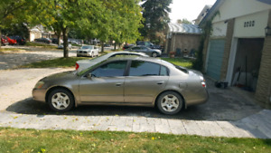 2003 Nissan Altima 2.5s great winter car comes with snow tires!