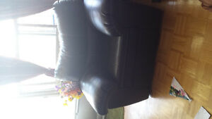 Black leather single couch