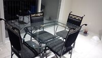 Glass Dining table with 4 chairs $100 or your best offer.