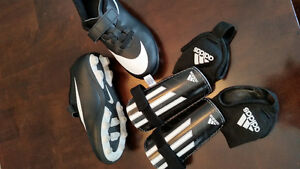 Boys soccer cleats and shin guards