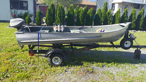 12 foot aluminum boat, motor and trailer and extras.