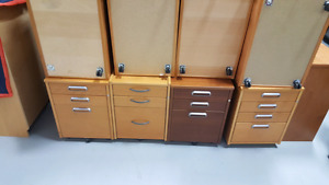 Wood file cabinet on wheels. $50.