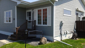 *New Price* End unit Garden home East, 2+1 bedroom, 2 baths