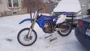 TRADE 3 FOR 1.......LOOKING FOR NEWER YZ OR YZF