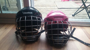 Childs size Reebok hockey helmets with face guards