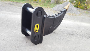 SEVERE DUTY ROOT RIPPER for an Excavator
