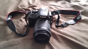 Mint condition Canon Rebel SL1 camera with soligor tripod