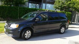 2013 Dodge Grand Caravan w/ roof rack, 2 bike racks, & Skybox 21