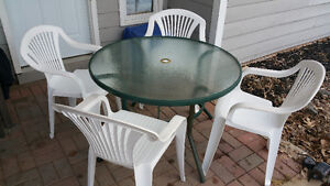 Patio table and 6 chairs. $60.