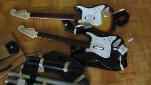 2 Guitares Fender, 1 batterie, 1 micro, 4 jeux pour Wii