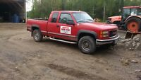 1998 extended cab GMC 2500 4x4 with plow. Low Km