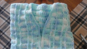 Several hand knitted baby items