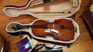 Menzel Cello, case, books, and stand