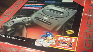 Sega Genesis with 2 controllers Sonic 2 and Aladdin in box