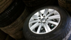 95% tread 195 65 15 tires on VW Jetta Golf Alloy rims 5 x 112