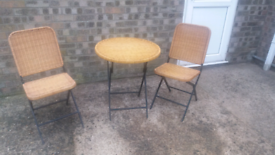 Wicker garden table and two chairs. Folds for easy storage £50.00. Lin