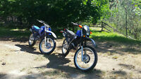 Two 250 yamaha dirtbikes.  1 dual purpose