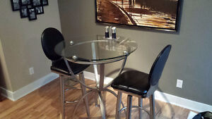 Round glass bistro style table for two
