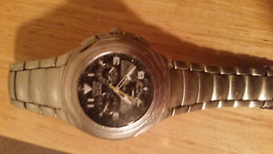 Eco-Drive Citizen watch with titanium wristband asking 800  obo
