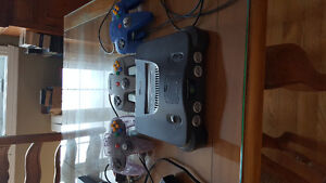 Nintendo 64 with expansion pack + 4 controllers