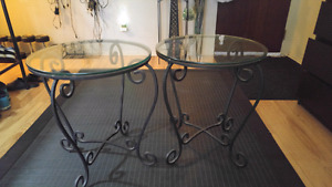 Two matching glass and wrought iron side tables