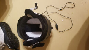 Snowboard, boots, binding and helmet with built in speaker.