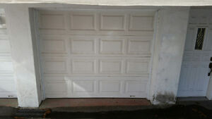 2 CLOPAY WHITE GARAGE DOORS WITH DOUBLE RAILINGS