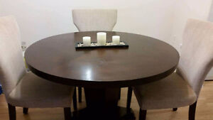 Dark brown table with 3 beige chairs