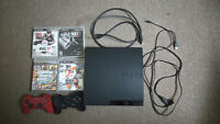 PS3 Slim 160gb with 2 controller and 8 games GTA 5, NHL 15,etc