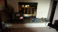 Wood Fireplace, mantel, brick, marble hearth, chimney, and tools