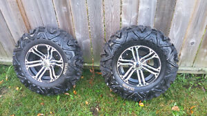 4 new mags & Traxion tires with spikes