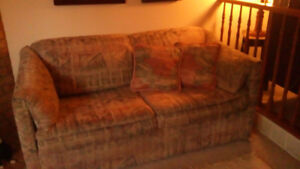 Love seat couch also a pull out bed with a Simmons mattress