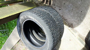 pair of 215/60r16 goodyear studed winter tires for sale,