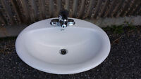 Porcelain Bathroom Sink and Faucets