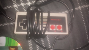 NES mario/duckhunt working gun and all controllers. Best offer