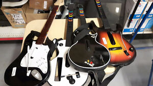Guitar de Guitar Hero ou Rock Band Console Dispo ci dessous