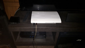 White 500 gb super slim ps3 with games n controllers