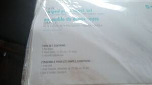 New Creme color twin bed sheet set.