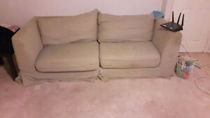 All must  go Couch/Futon with mattress wood frame and headboard