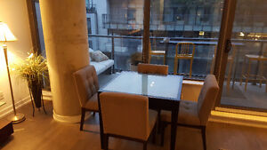extended dinning table with chairs perfect for condos.