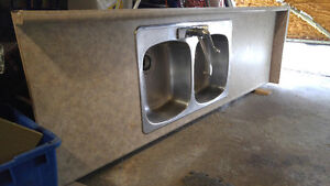 Countertops with stainless double sink and tap
