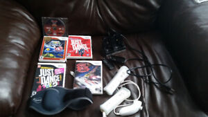 Nintendo Wii for sale. Including Wii fit board and lots of games