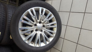 Goodyear (P225/50R18) tires on aluminum rims. Good condition!