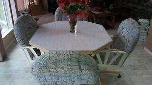 Kitchen Table w/Leaf & 4 padded, swivel chairs on casters.