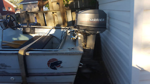 30hp Mariner with steering and controls. Runs mint.