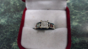 14 kt , Princess Cut Engagement  Ring .  Size 4.5 in White Gold.