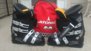 Salomon ski boots with carrying bag.