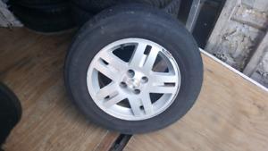 4 Mag Chev Aveo-Cobalt avec 4 pneu ete bon etat