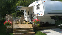 30' 5th Wheel Cougar by Keystone Trailer at Orr Lake, with deck